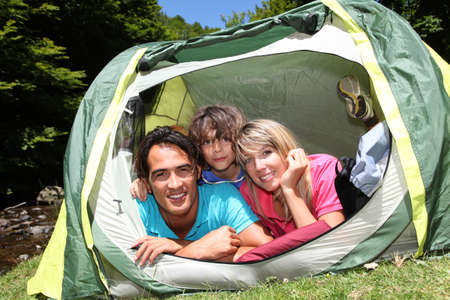 Family camping in mountain during summer vacation photo