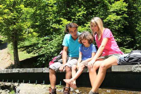 rambling: Family sitting on bridge over mountain river