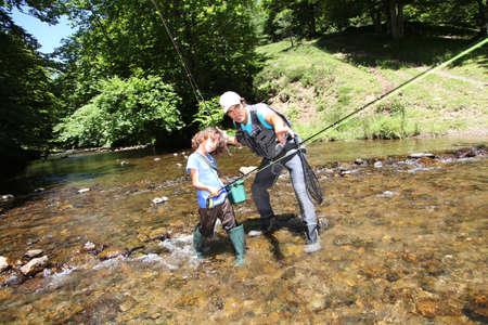 line fishing: Father teaching little boy to fish