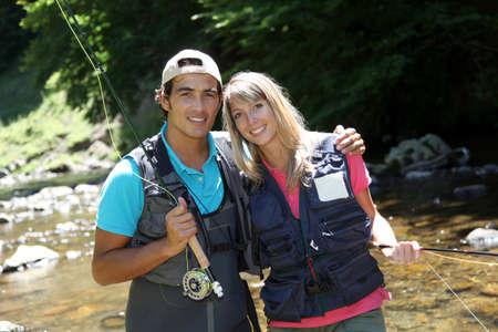 flyfishing: Portrait of couple flyfishing in river Stock Photo