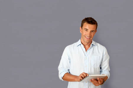 Handsome man using electronic tablet  photo