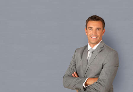 Portrait of businessman standing with arms crossed photo