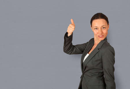 Businesswoman showing thumb up photo