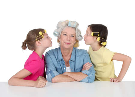 hair curlers: Senior woman and kids with hair curlers