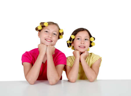Portrait of young girls with hair curlers Stock Photo - 9902392