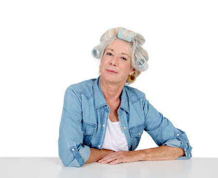 hair curlers: Portrait of senior woman with hair curlers
