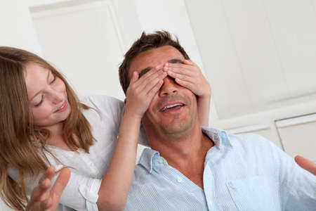guessing: Girl hiding her fathers eyes Stock Photo