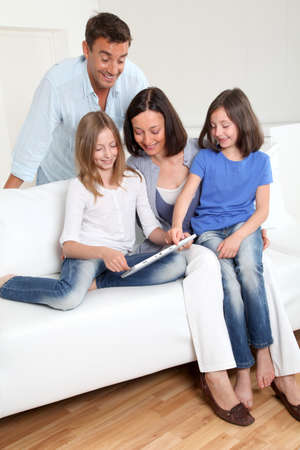 Parents and children using electronic tablet at home Stock Photo - 9903787
