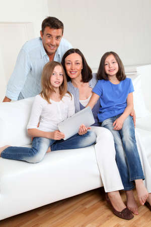 Parents and children using electronic tablet at home Stock Photo - 9903333