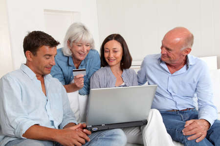Senior people with couple doing shopping online photo