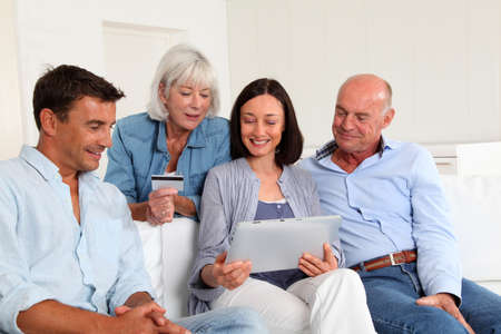 secured payment: Senior people with couple doing shopping online Stock Photo