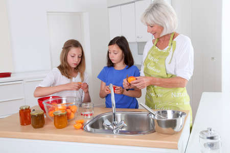 Senior woman making apricot jam with grandkids Stock Photo - 9907125