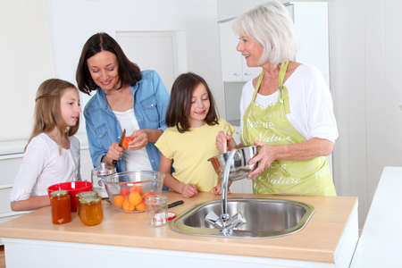 Portrait of grandmother, mother and kids in kitchen Stock Photo - 9907127