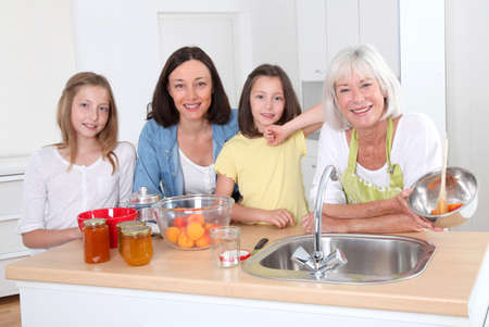 Portrait of grandmother, mother and kids in kitchen Stock Photo - 9909626