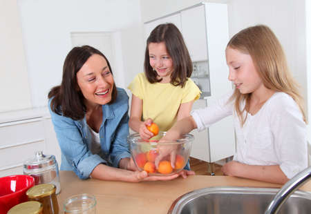 Mother and daughters in kitchen Stock Photo - 9901323