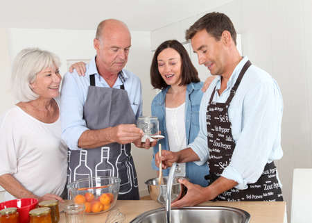 Family preparing fruit jam in home kitchen Stock Photo - 9903301