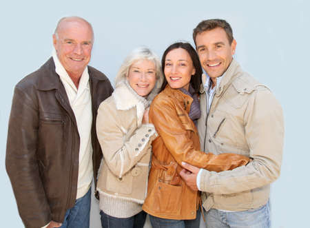 winter jacket: Happy family portrait in winter time Stock Photo