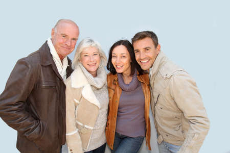 family fall: Happy family portrait in winter time Stock Photo