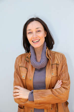 turtleneck: Portrait of smiling woman with turtleneck sweater