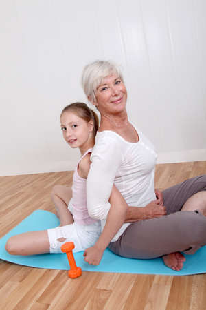 grandkid: Grandmother and young girl doing fitness exercises Stock Photo