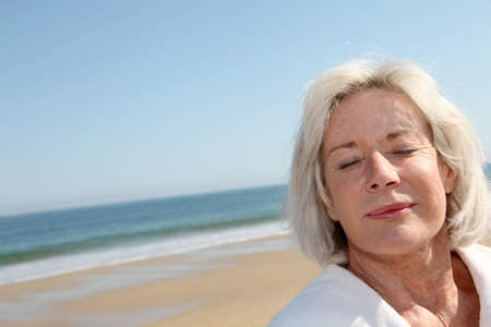 spa resort: Portrait of happy senior woman in spa resort