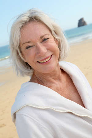 Portrait of happy senior woman in spa resort photo