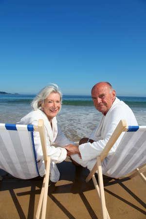 Portrait of senior couple sitting in deckchairs Stock Photo - 9903775
