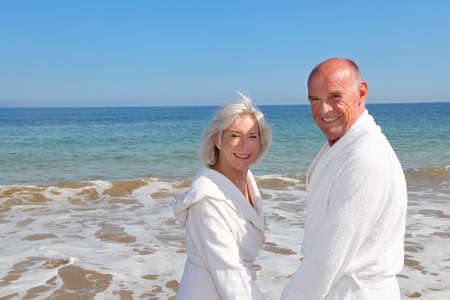 Portrait of senior couple relaxing on a resort beach photo