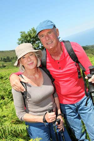 Portrait of happy senior couple hiking in natural landscape Stock Photo - 9909407