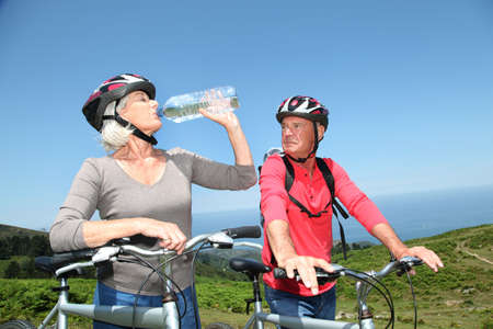 Senior couple drinking water during bike ride Stock Photo - 9903361