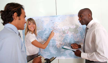 global logistics: Business team looking at world map Stock Photo