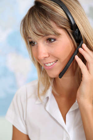 Portrait of smiling teleoperator with headset photo