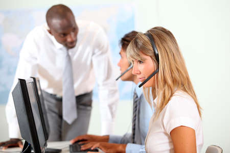 Office people working in front of helpdesk photo