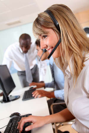Office people working in front of helpdesk Stock Photo - 9901218