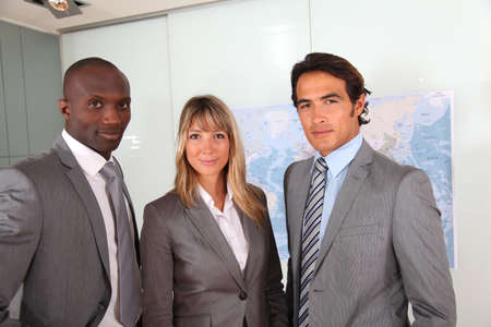 Business people standing in office photo