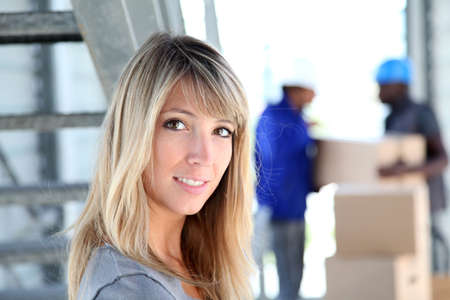 shipment: Portrait of beautiful woman standing in warehouse