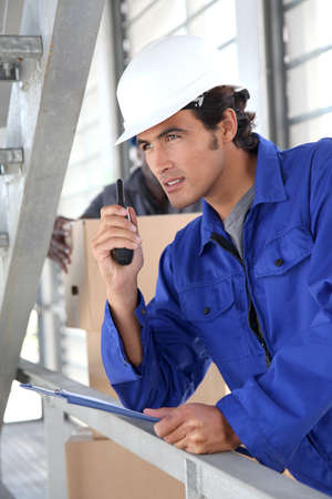 Warehouse manager using walkie-talkie Stock Photo - 9903782