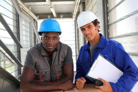 Portrait of storemen in warehouse  photo