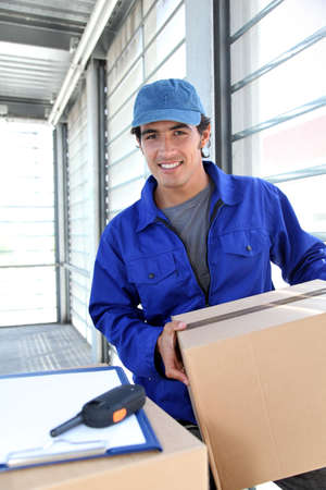 Portrait of smiling delivery man  photo