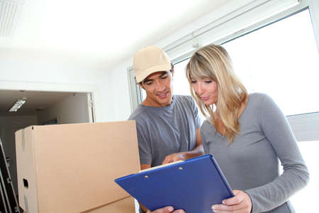 order shipping: Woman with delivery man checking order contract