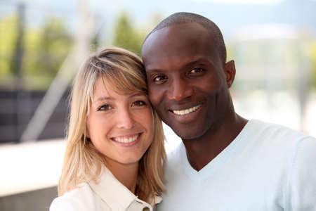 mixed couple: Portrait of happy mixed couple