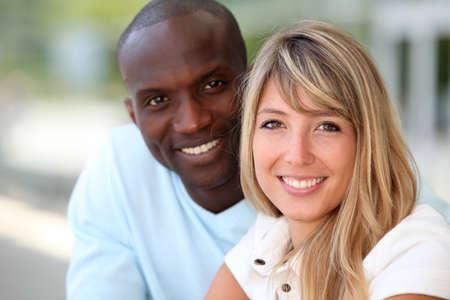 Portrait of happy mixed couple photo