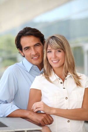 latino man: Portrait of handsome couple standing outside