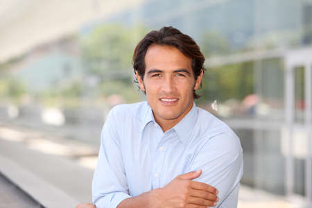 charming: Portrait of handsome man standing outside Stock Photo