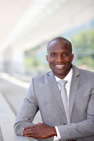 Portrait of handsome businessman wearing grey suit photo