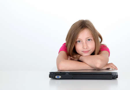 parental control: Teenaged girl with arms crossed on laptop computer