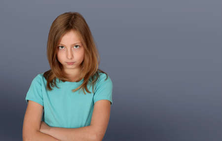 Portrait of young girl with upset look photo