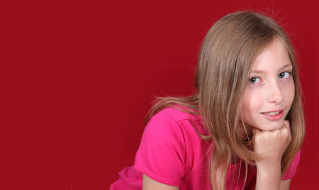 10 years girls: Portrait of beautiful blond girl on red background