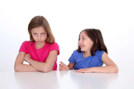 10 years girls: Little girl making fun of her sister