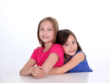 complicit�: Portrait of young sisters showing complicity